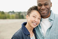 Portrait of interracial couple at beach