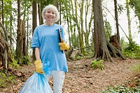 Mature woman helping to clean up park