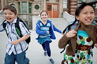Elementary students running outside school