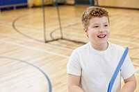 Male student with floor hockey stick