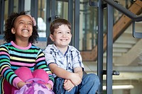 Two elementary students sitting in stairway