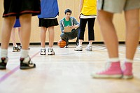 Middle school students getting instruction on basketball (thumbnail)