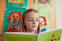 School girl 8_9 reading book