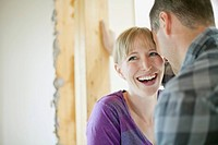 Couple being affectionate while renovating (thumbnail)