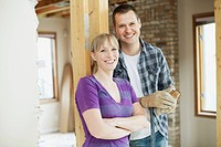 Happy, mid adult couple in house renovation