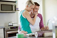 Mid adult couple being affectionate in kitchen