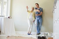 Mid adult couple getting ready to paint