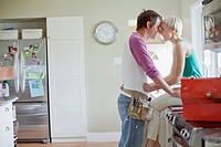 Mid adult couple being affectionate in kitchen (thumbnail)