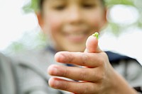 Elementary student observing caterpillar