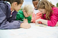 Elementary students using navigation tools outdoors