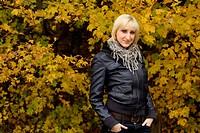 Beautiful girl enjoys autumn