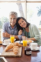 Portrait of couple at breakfast table