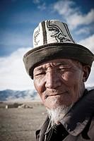 Portrait of a old Kyrgyz Man with traditional hat Kalpak, Karakul, Tajikistan