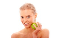 Beautiful girl eating green apple