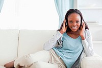 Woman relaxing on couch with headphones on