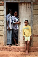 Mother, father and daughter outside their home, Waikkal Village, Sri Lanka