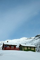 typical mountain huts in Norway  Sun and snow