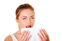 Teen woman with tissue