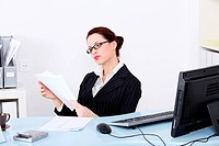 Businesswoman reading files.