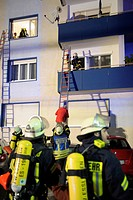 Apartment fire in an apartment building, firefighters rescueing people from a balcony, Esslingen, Baden-Wuerttemberg, Germany, Europe