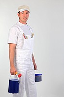 Male painter carrying paint pots