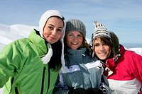 Three female friends skiing
