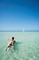 Man over surf board swimming. ´Es trenc´, Majorca, Balearic Islands