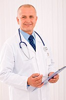 Mature doctor male portrait write document