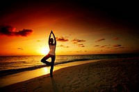 sunset yoga woman