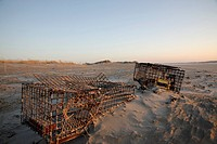 Lobster traps at sunrise on Hampton Beach, New Hampshire USA which is part of the New England seacoast
