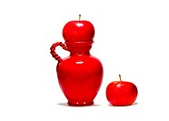 two apple and red jug on white