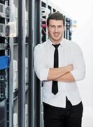 young handsome business man it engeneer in datacenter server room