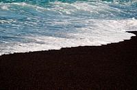 Black volcanic sand beach