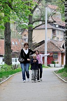 happy young family walking outdoor in park