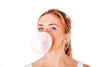 Teen woman blowing bubble gum