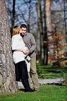 happy young married family couple outdoor in nature have fun and waiting baby and representing young family growth and pregnancy concept