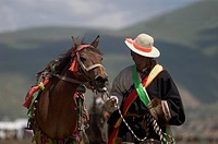 Khampas, the warrior horseman of old Tibet, compete at the Litang Horse Festival _ Kham, Sichuan Province, China, Tibet