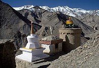 PRAYER STUPAS atop a hillside with HIMALAYAN PEAKS, LAMAYURU _ LADAKH, INDIA
