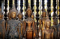 Antique wooden Buddhas in the former Provincial town of LUANG PROBANG _ LAOS