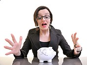 young business woman iosolated on white putting coins money in piggy bank and representing concept of saving and smart spending money