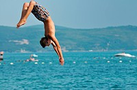 happyfriend boys group have fun and jump in sea at summer vacation