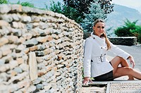 young woman posing in fashionable clothing outdoor