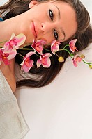 beauty halth and spa wellness isolated young woman face portrait closeup with towel and flower treatment