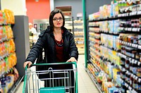 young woman buy and shop food in supermarket