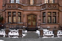 A BROWNSTONE in WINTER with SNOW on the sidewalk _ NEW YORK CITY, NEW YORK, USA