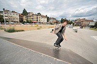 Boy practicing skate in a skate park _ isolated