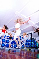 group of young girls stepping in fitness club