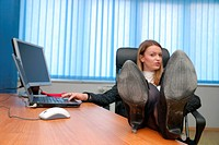 .business woman relaxing with her feet on the desk