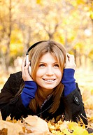 Portrait of a woman at outdoor with headphones