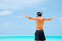 Young man ready to go snorkeling wide open arms